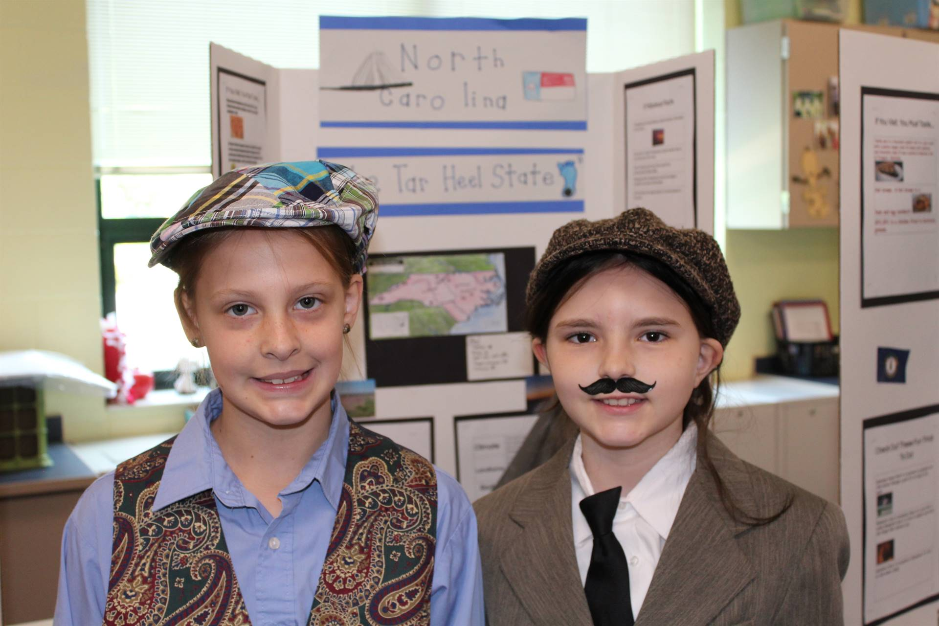 two students dressed as the Wright Brothers for the State Fair