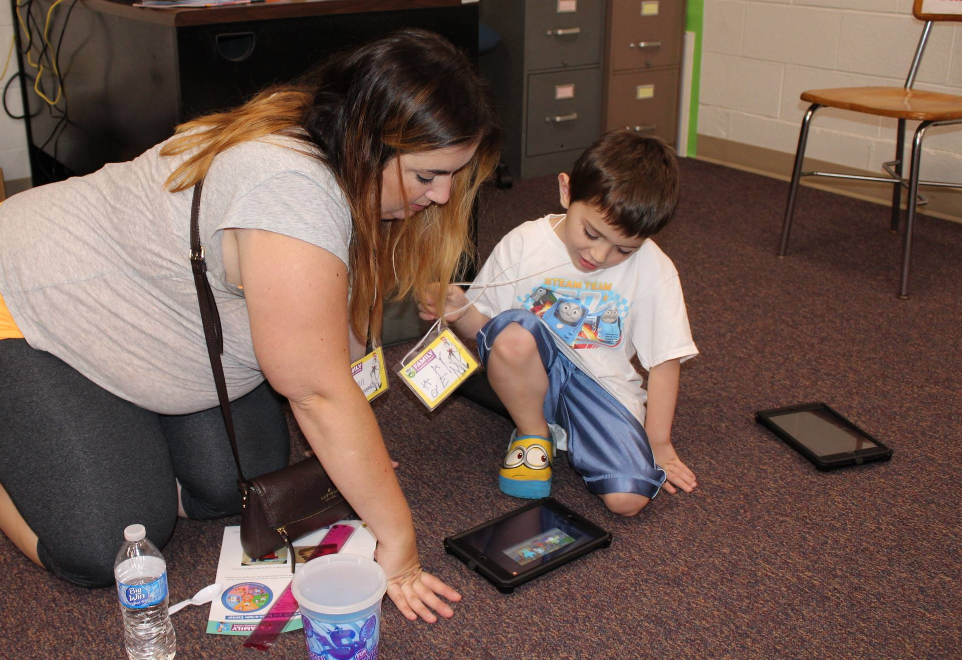 Parent and student working together on an iPad