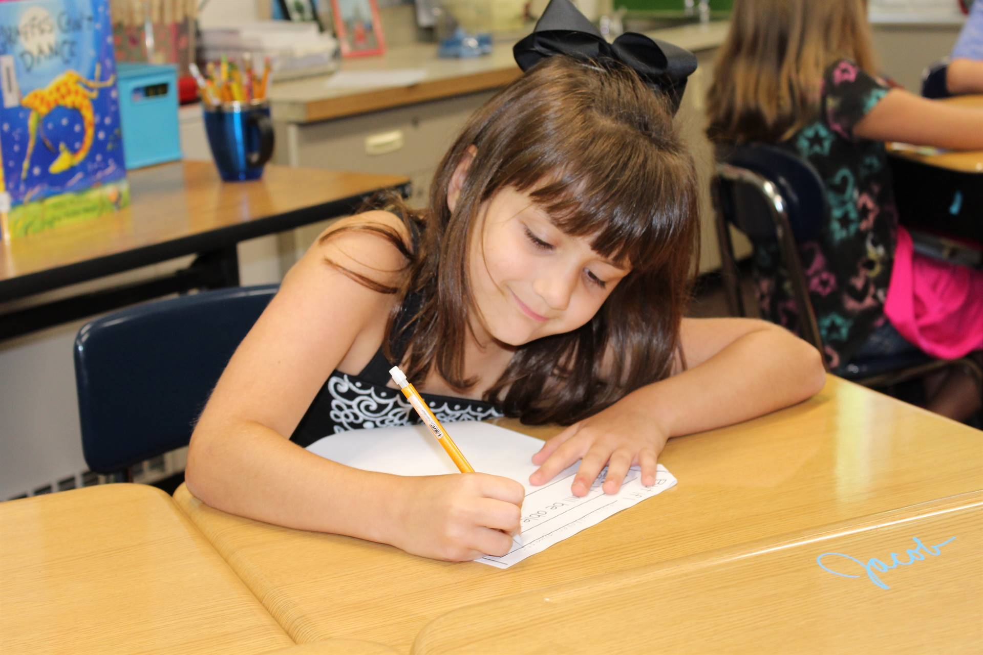 Student completing her Yet worksheet