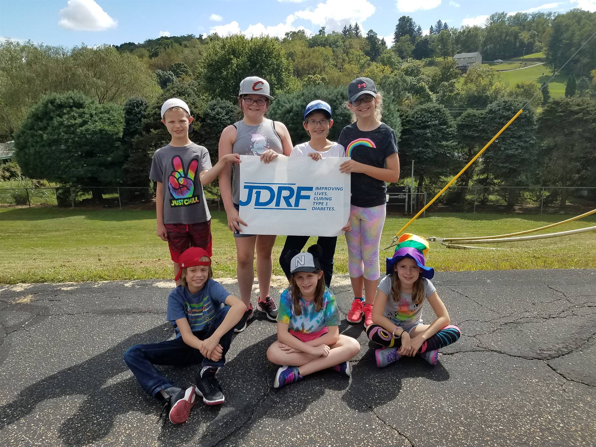 Seven students holding a sign for JDRF