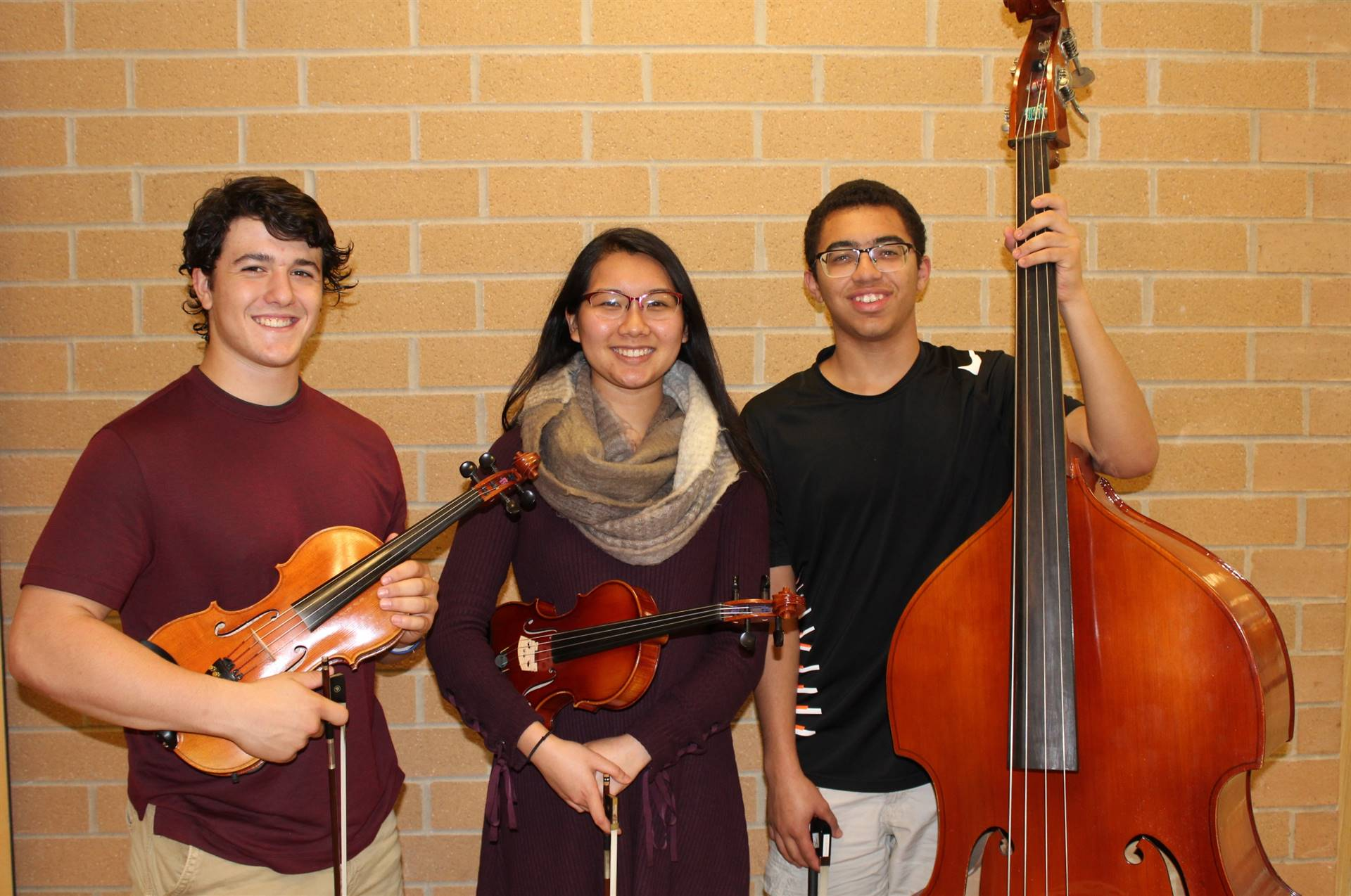 The three BPHS Honors Orchestra musicians