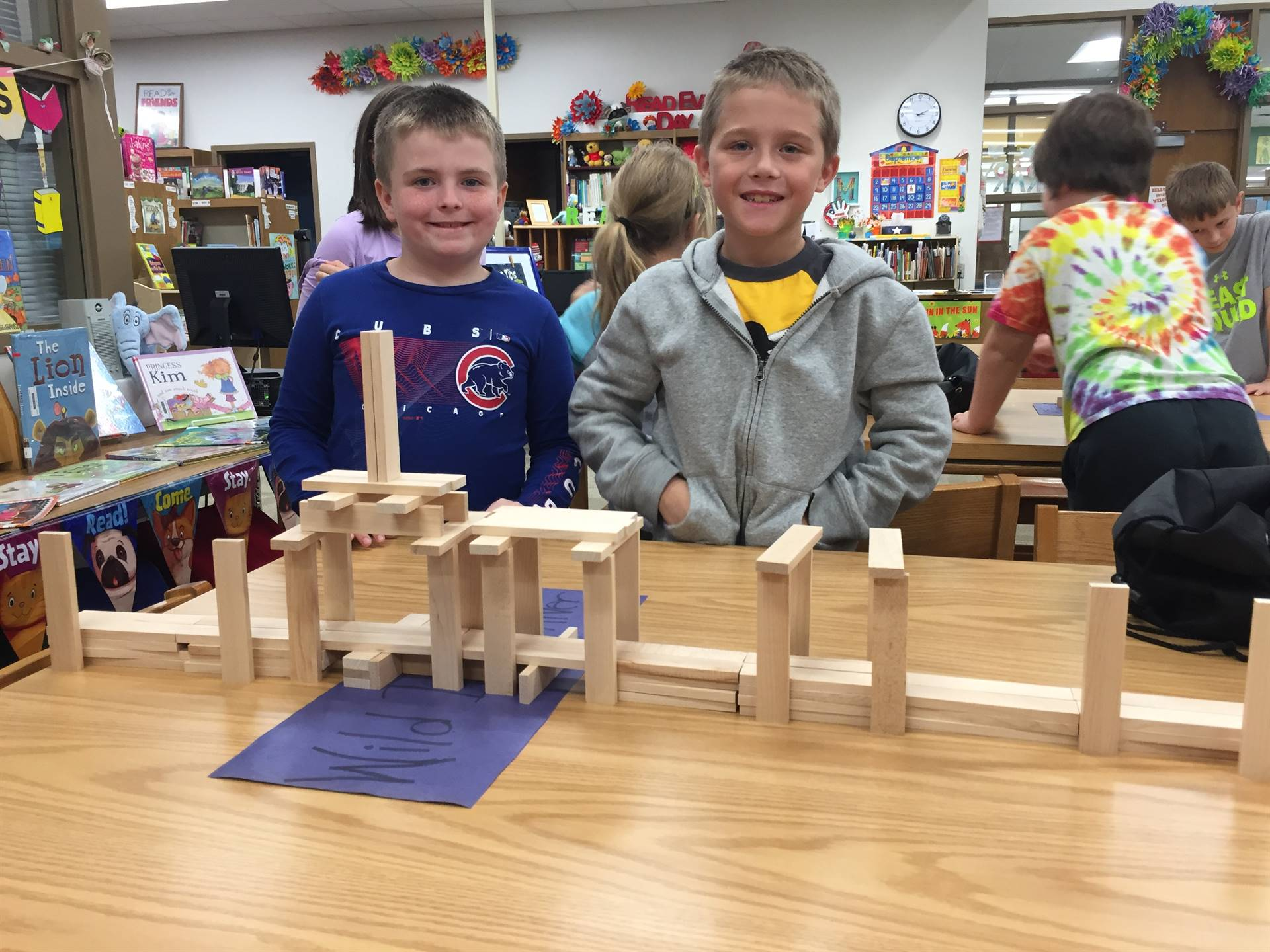 Two Second Graders with their KEVA Plank Bridge
