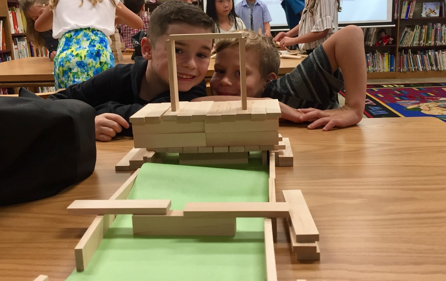 Two Washington students with their KEVA plank bridges