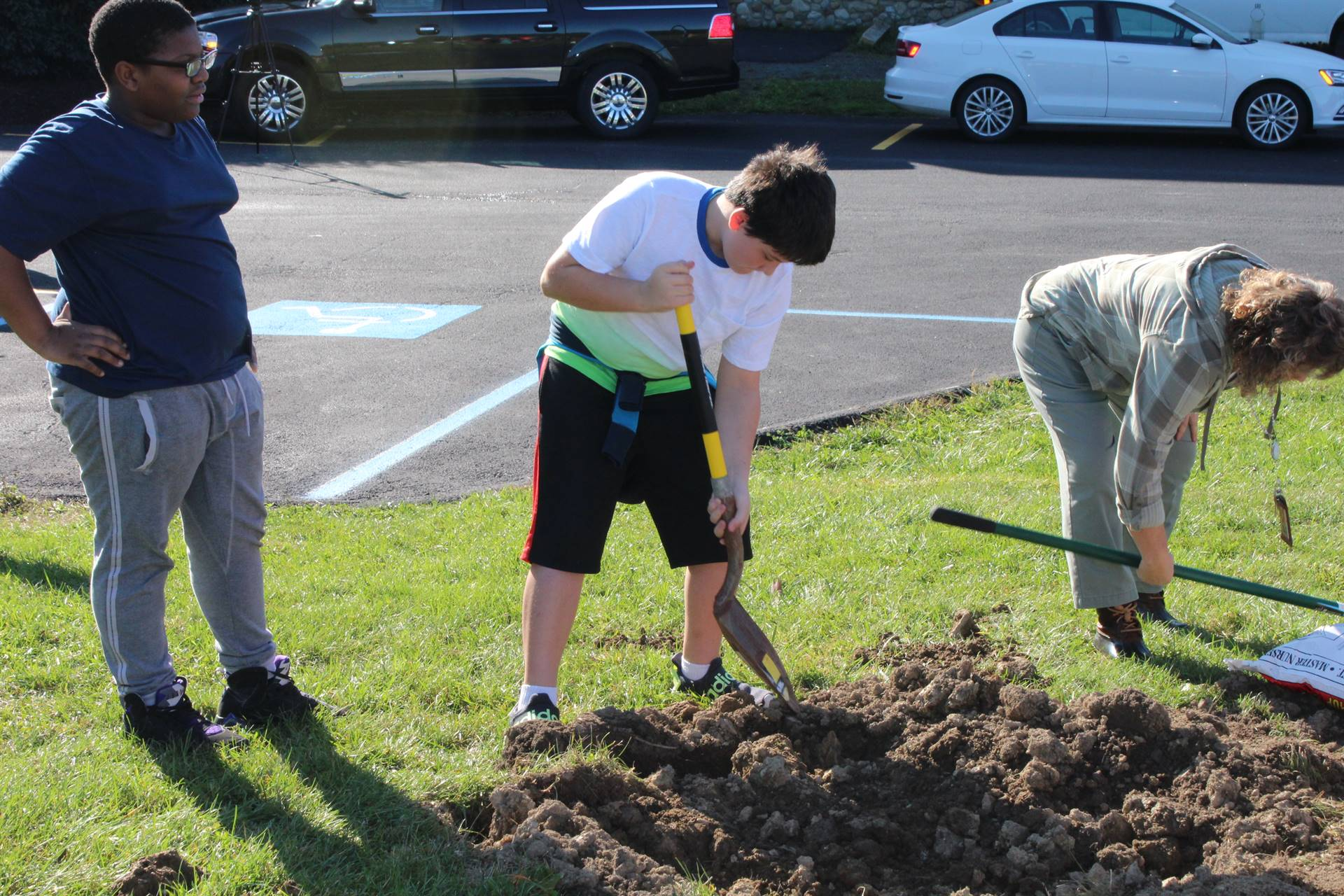 Student shoveling a hole