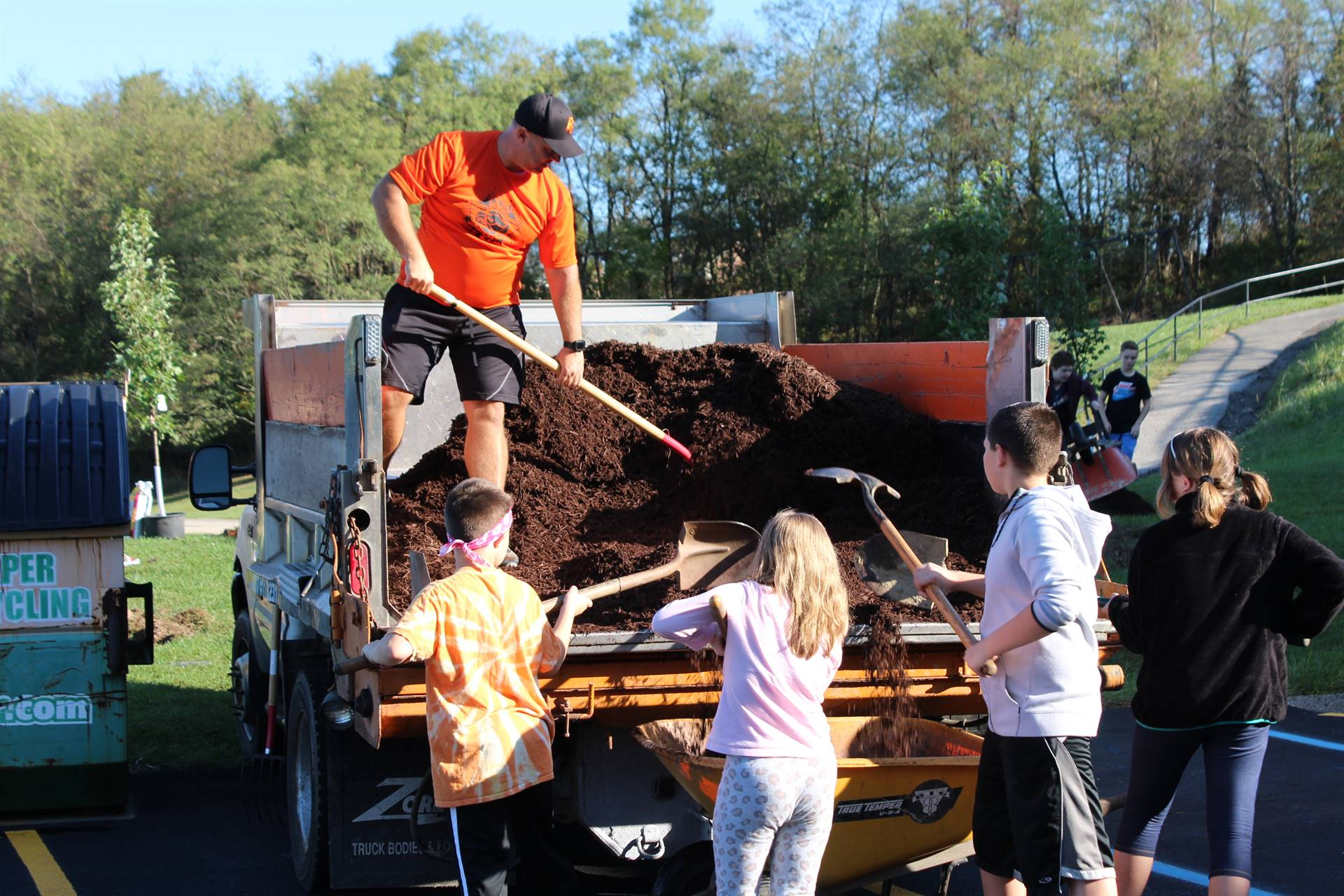 Mr. Espinar moving mulch off of a truck