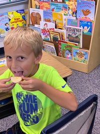 Student eating an apple slice