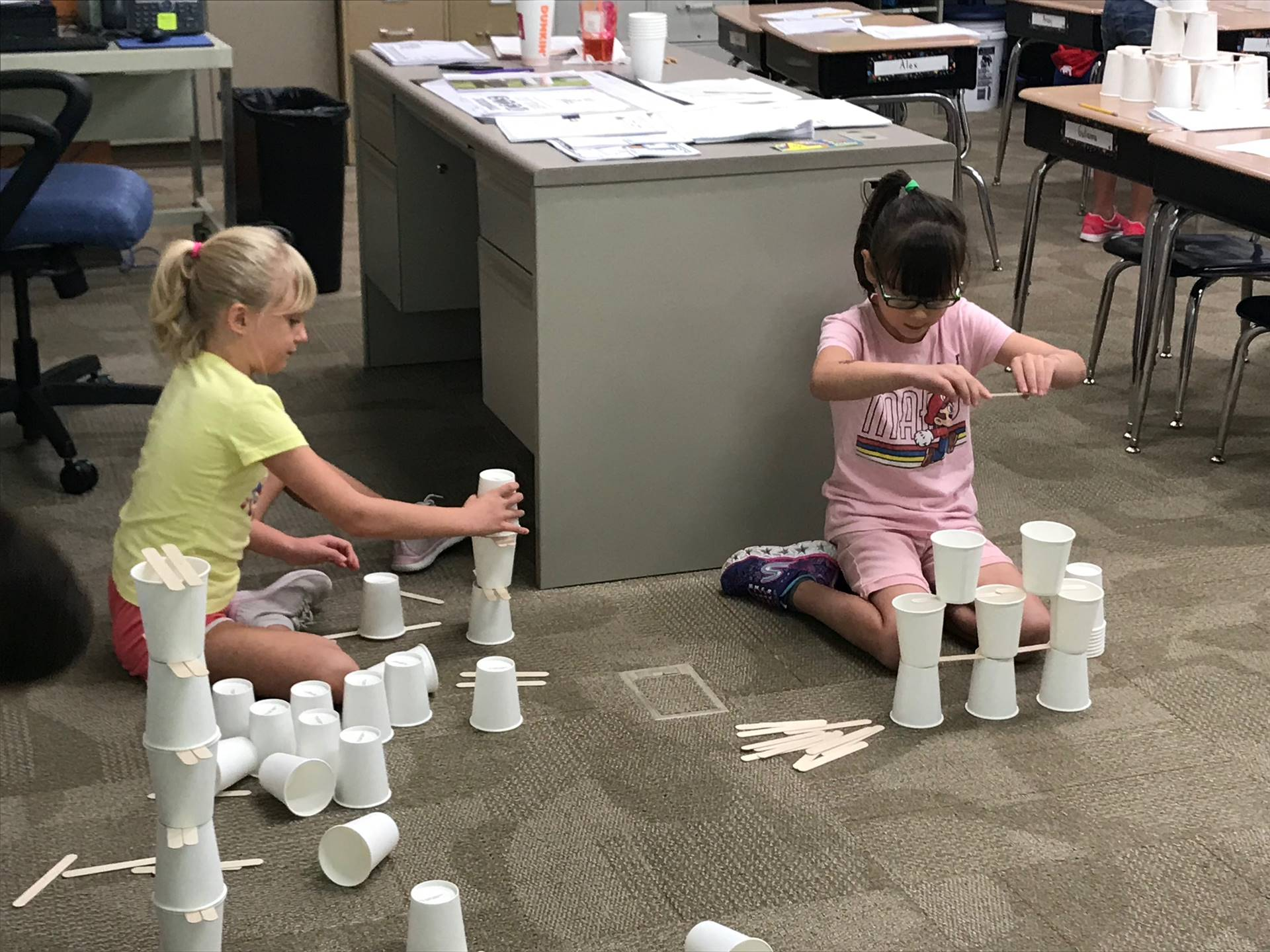 Two students building their towers