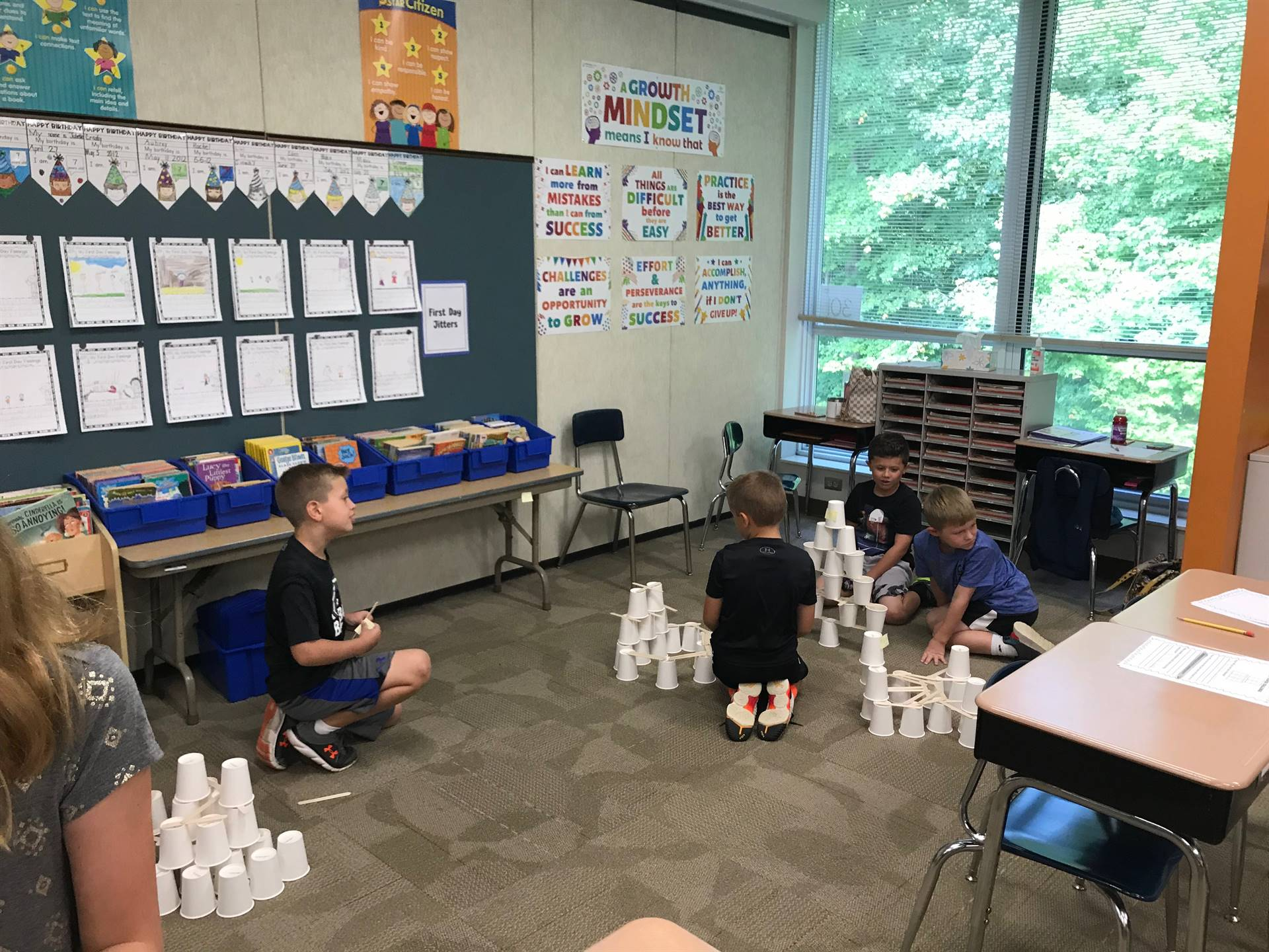 Four students working on their towers