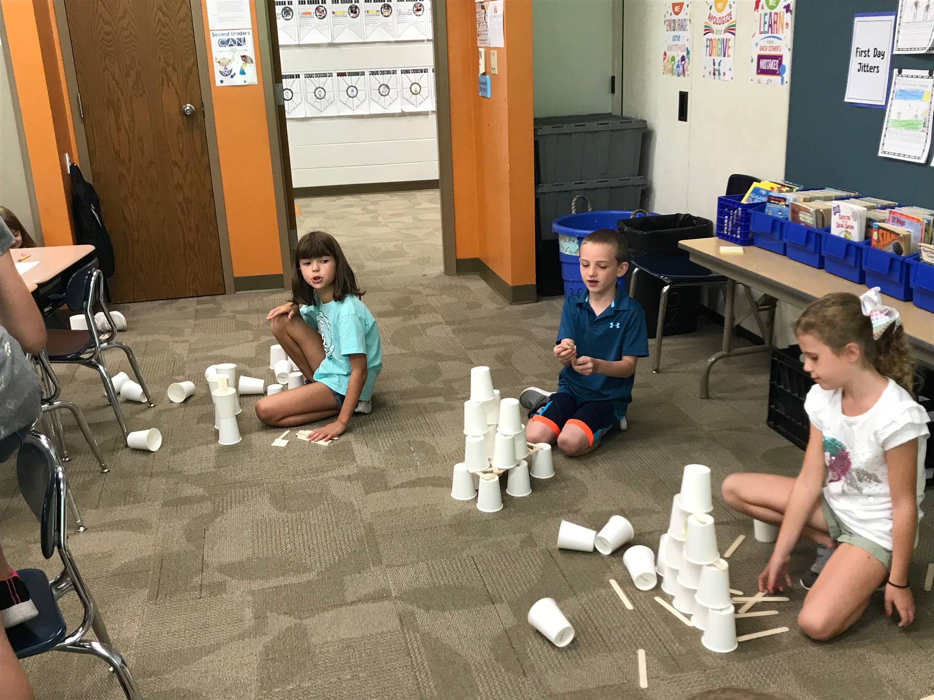 Three students working on their towers