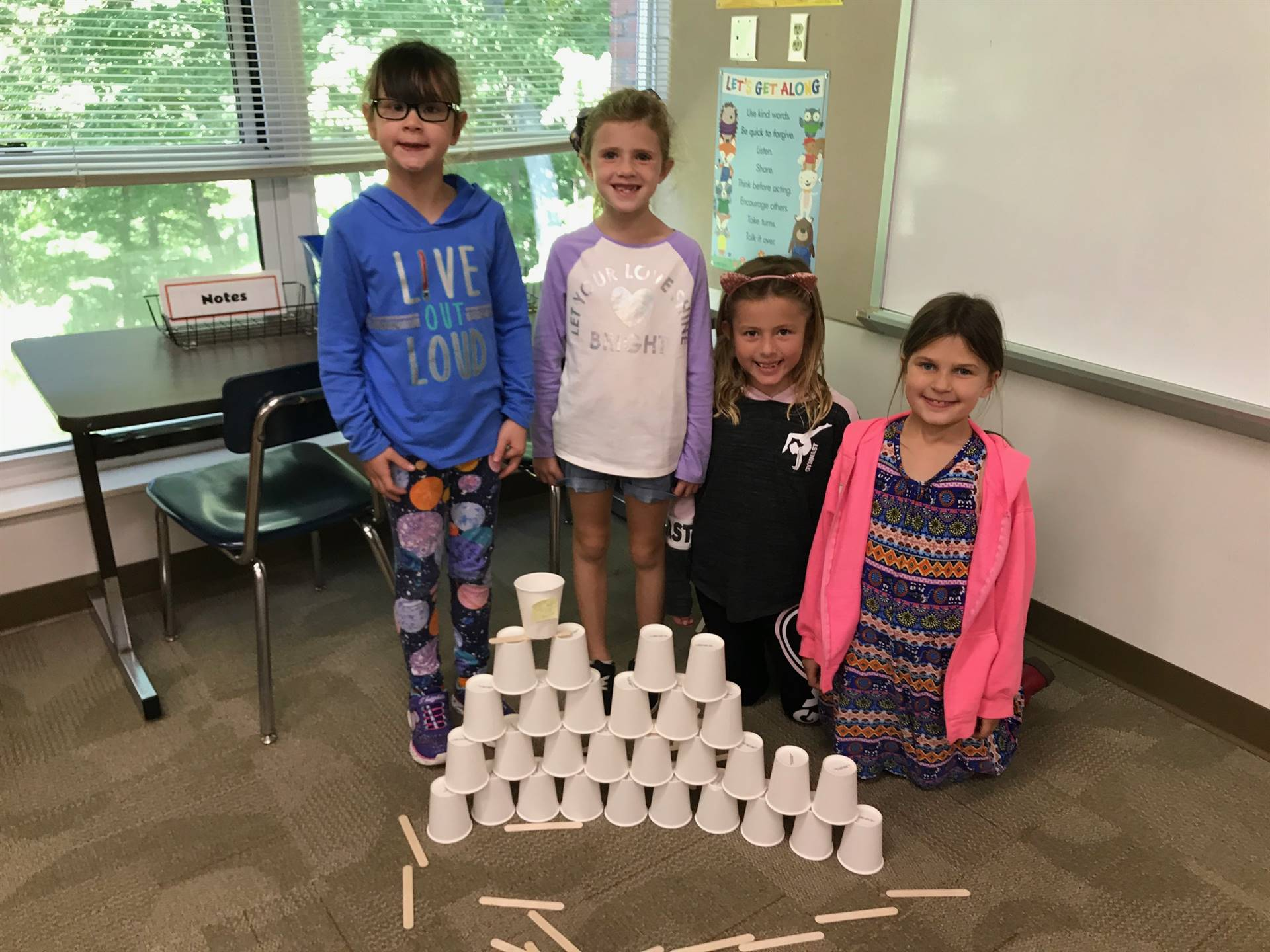 Four students with their tower
