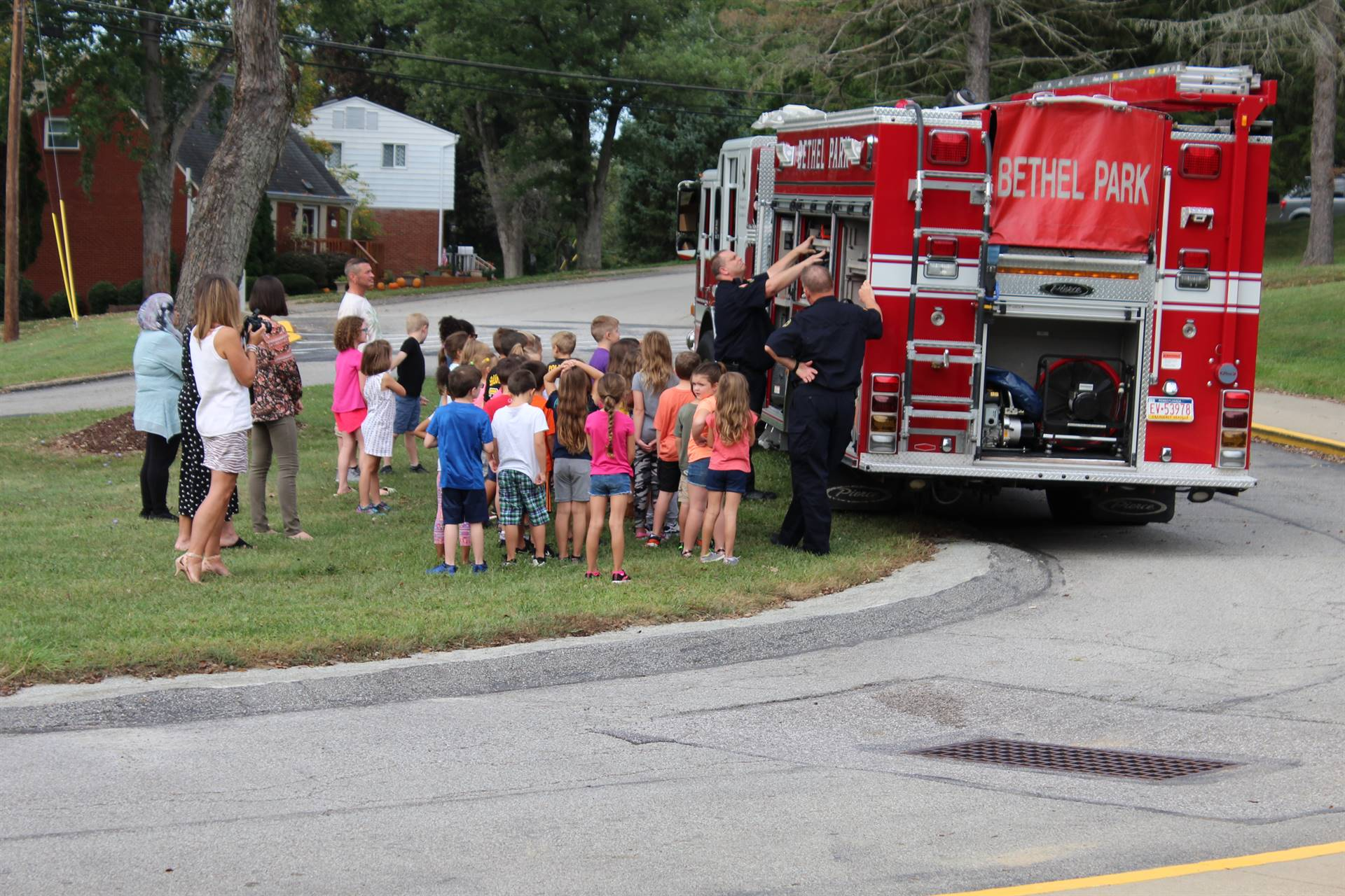 Students gathered around the fire truck