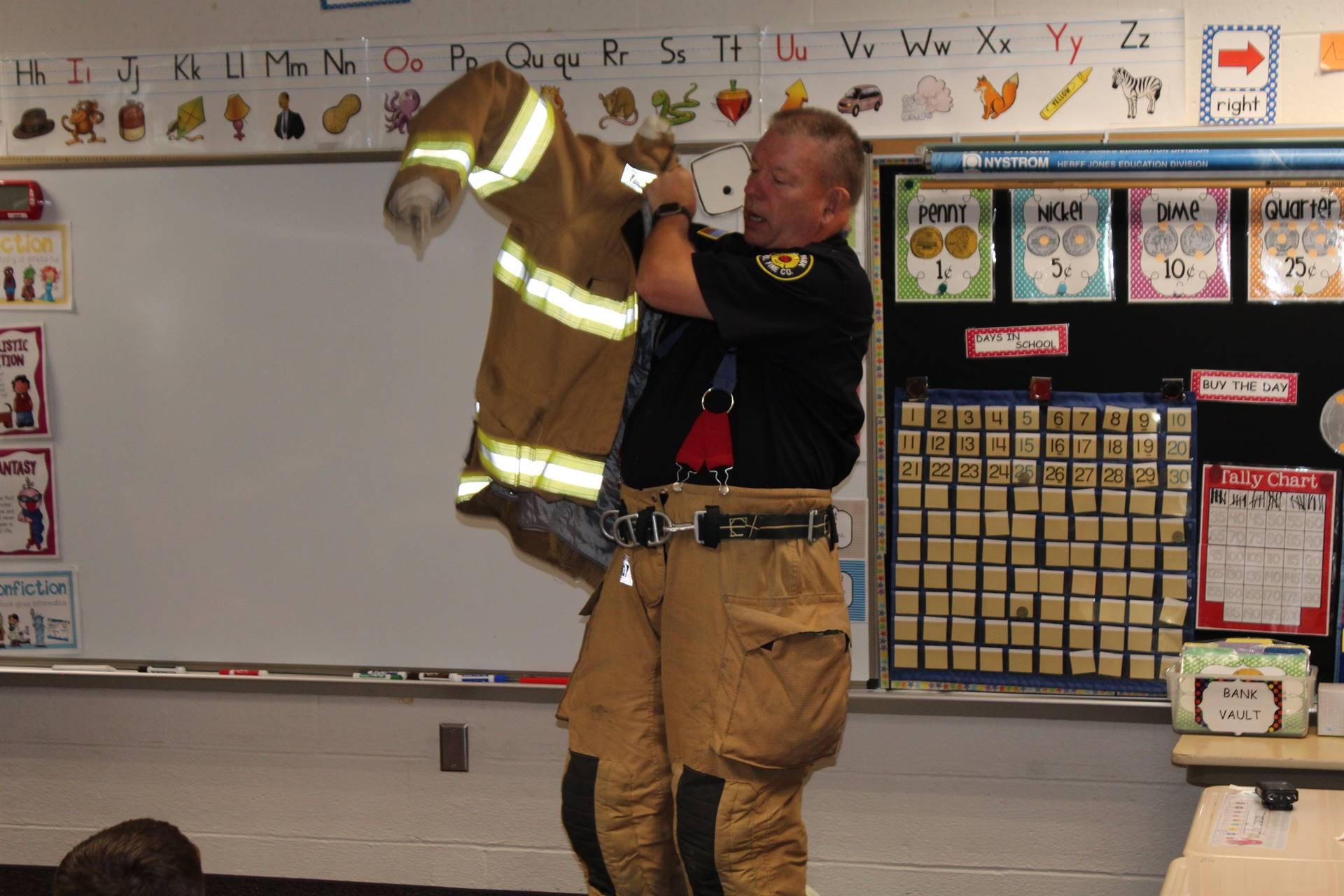 Fireman putting on his coat