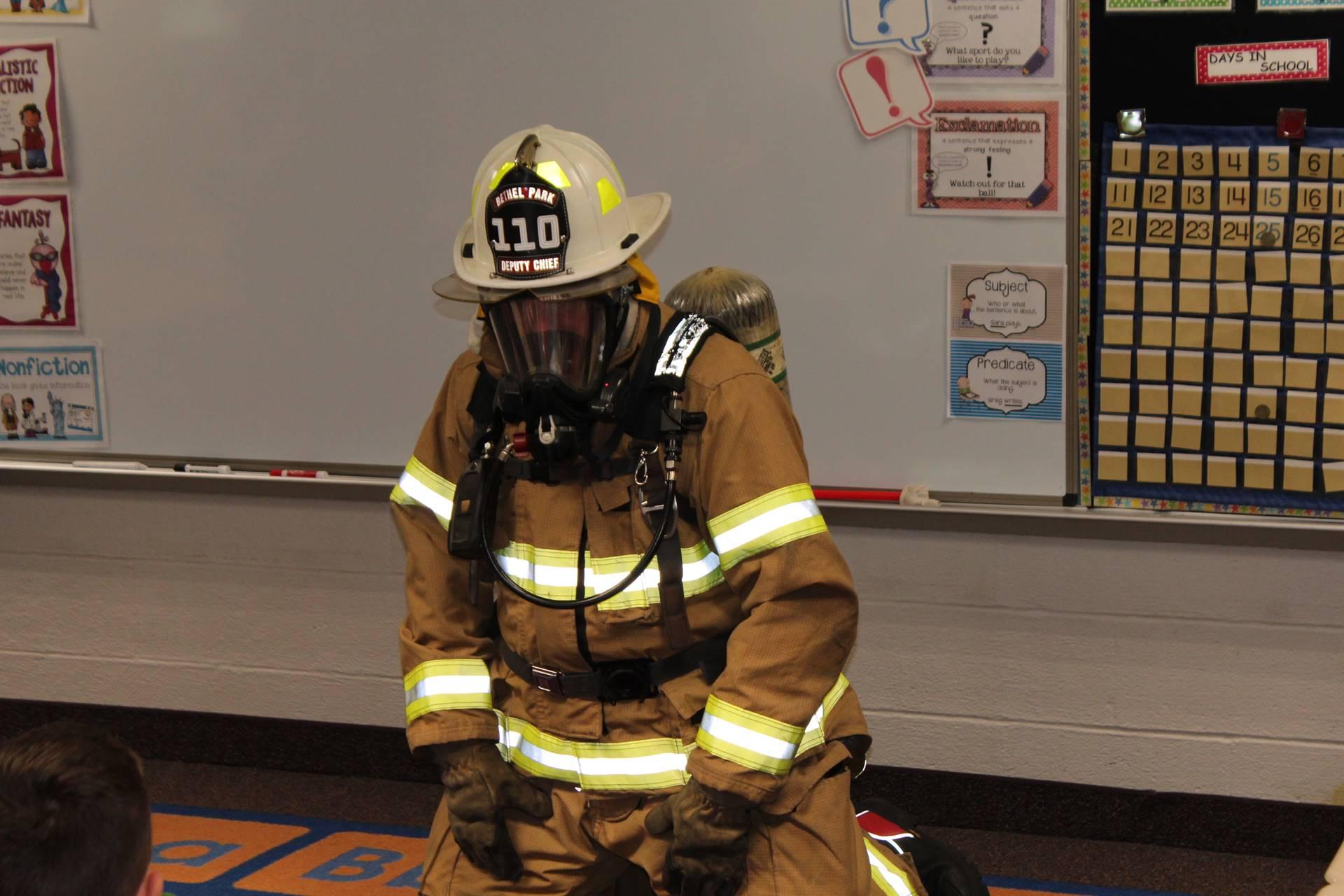 Fireman demonstrating getting low