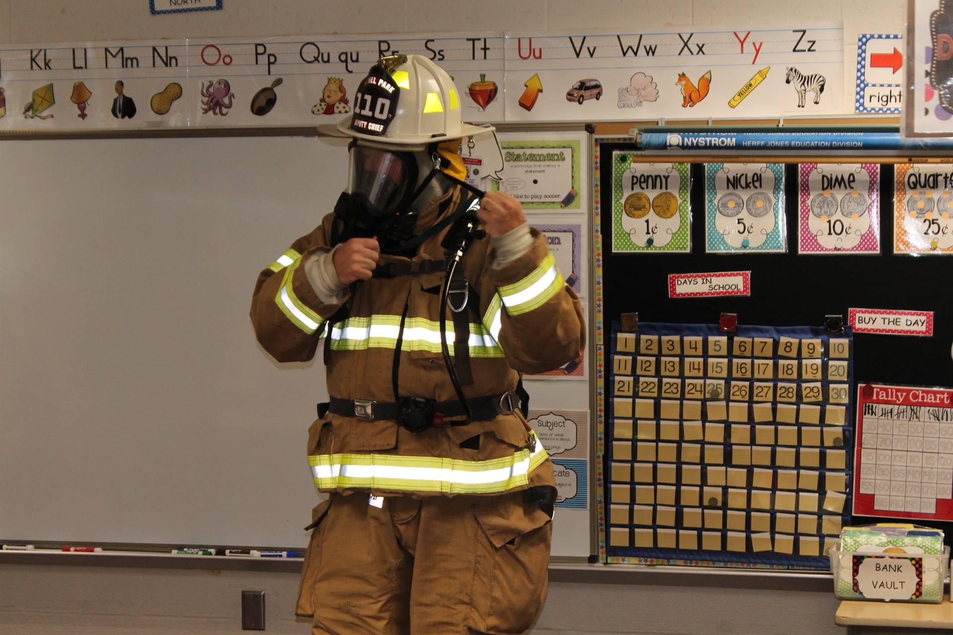 Fireman putting on his respirator