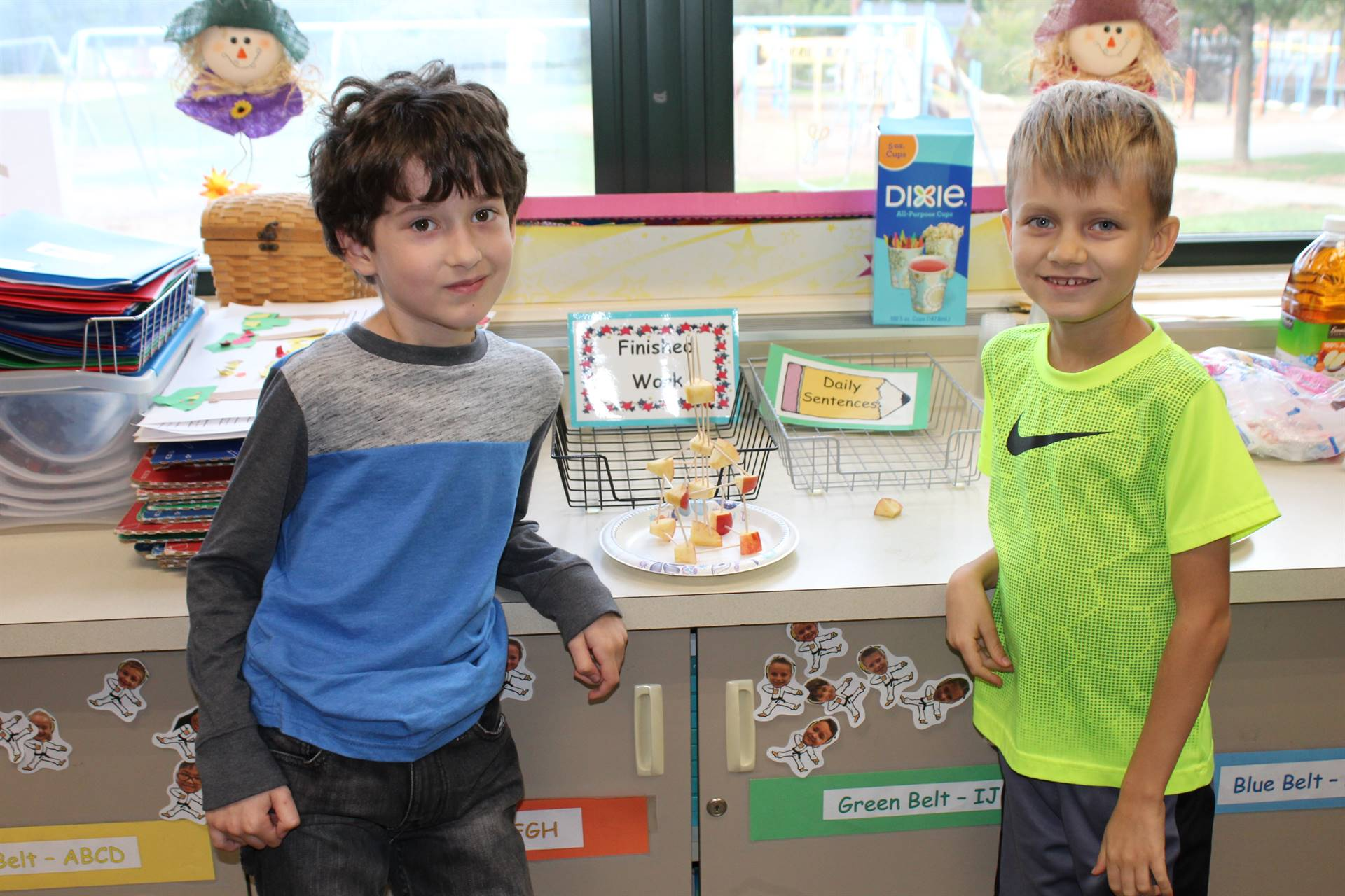 Two students with their apple STEAM tower