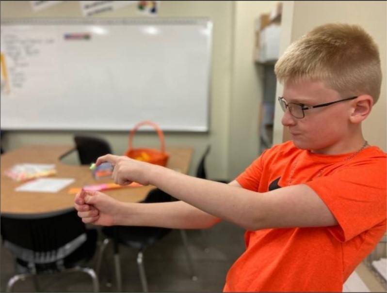Student testing his catapult