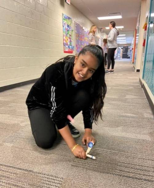 Student testing her catapult
