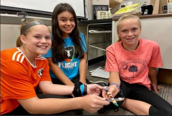 Three students with their catapult