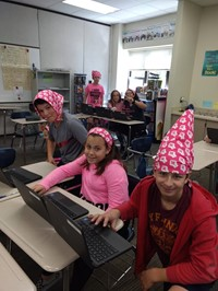 Three students wearing bandannas
