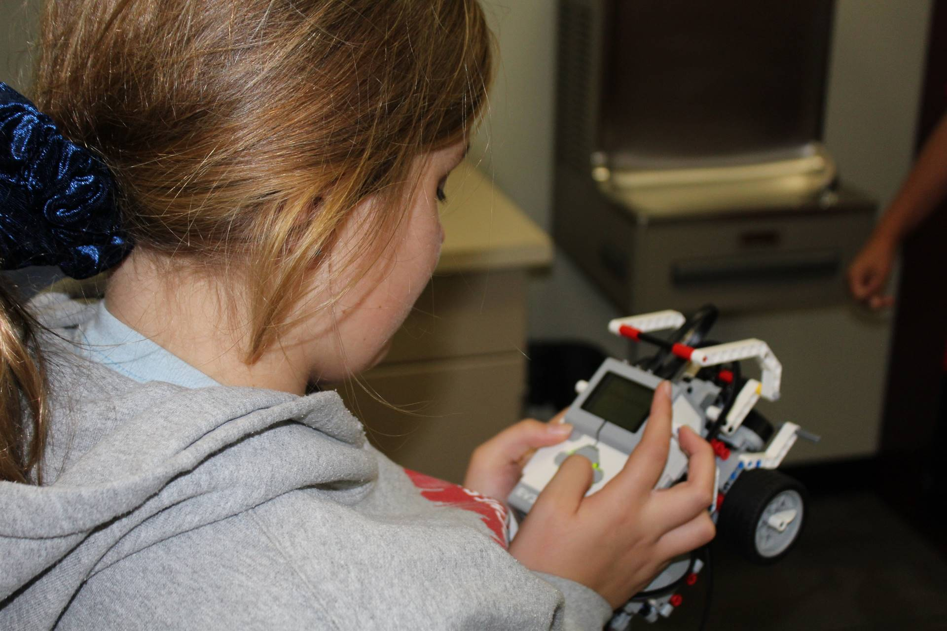 Student programming the robot