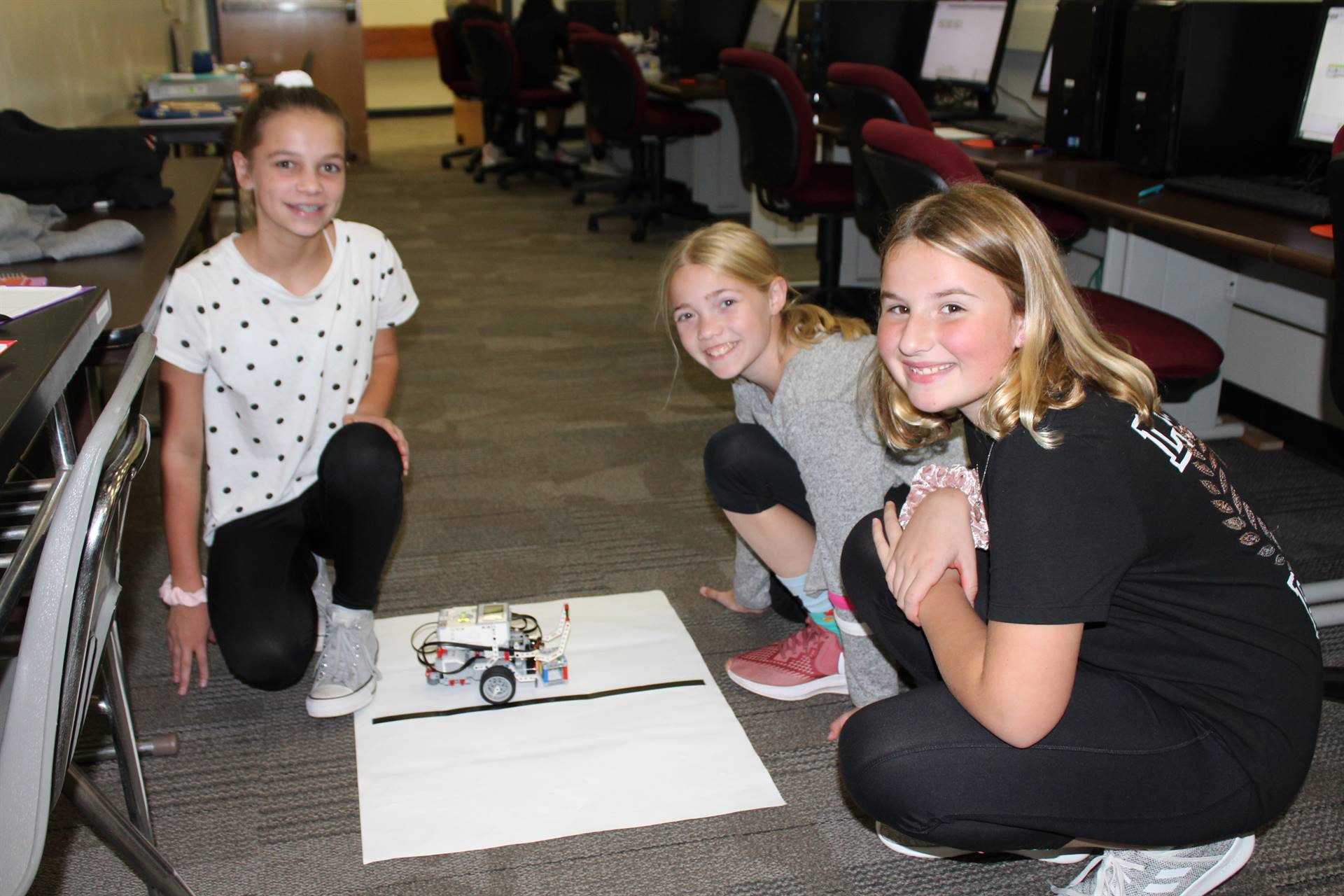 Three students with their robot