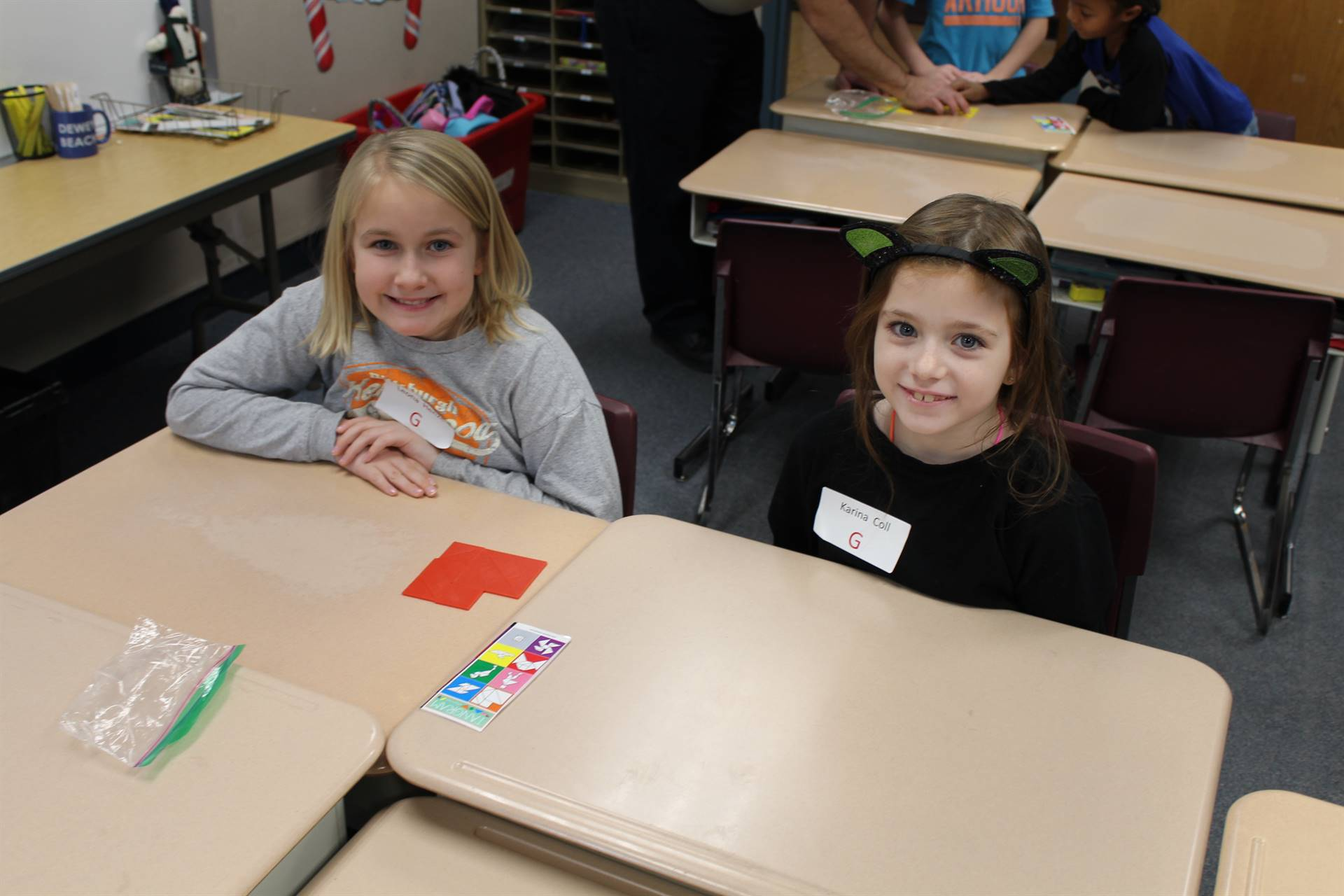 Two students working on tangrams