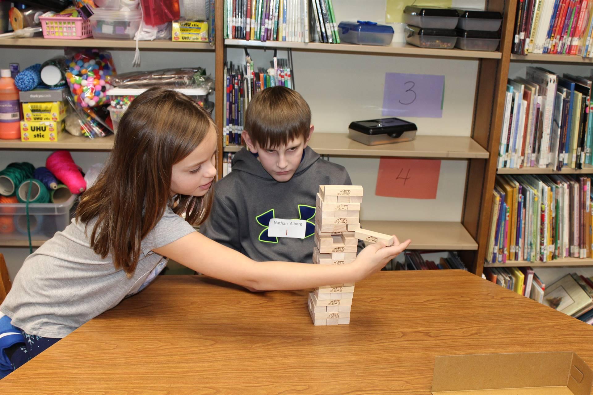 Two students playing Jenga