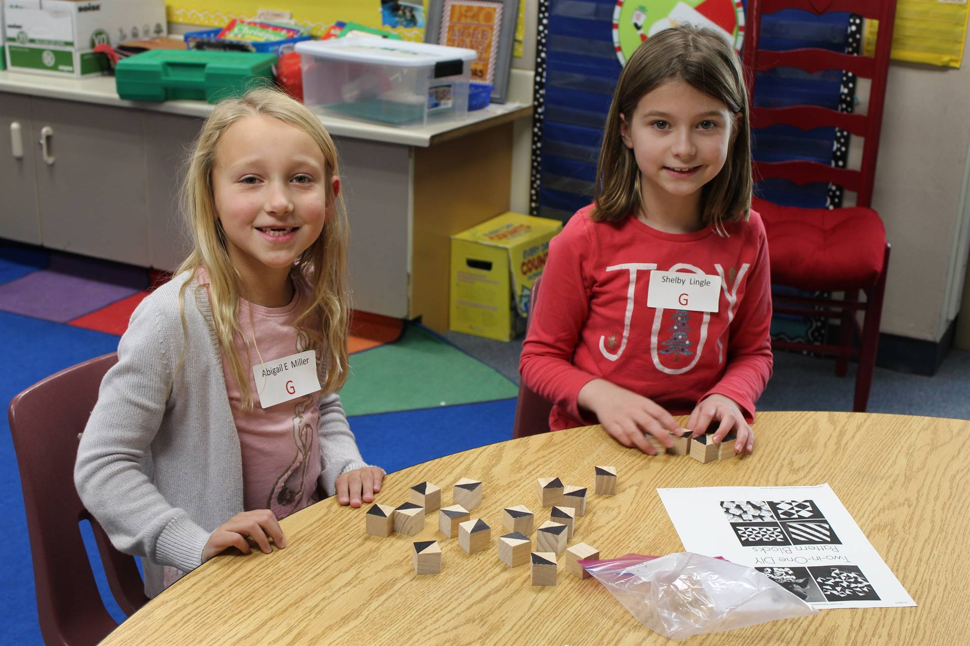 Two students getting ready to work with patterned blocks