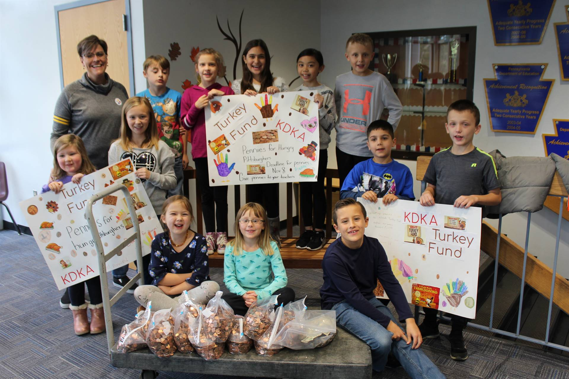Mrs. Reese and Memorial students with the money collected for the KDKA Turkey Fund