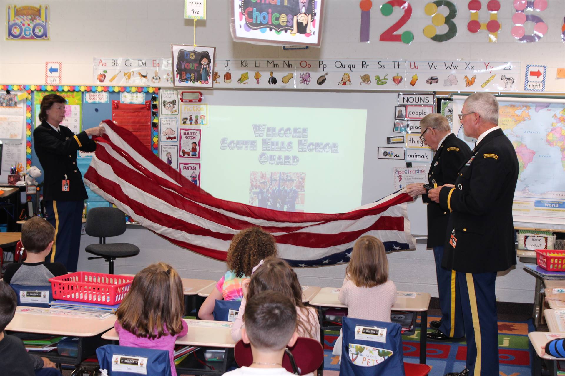 The Honor Guard shows the students how to properly fold an American flag