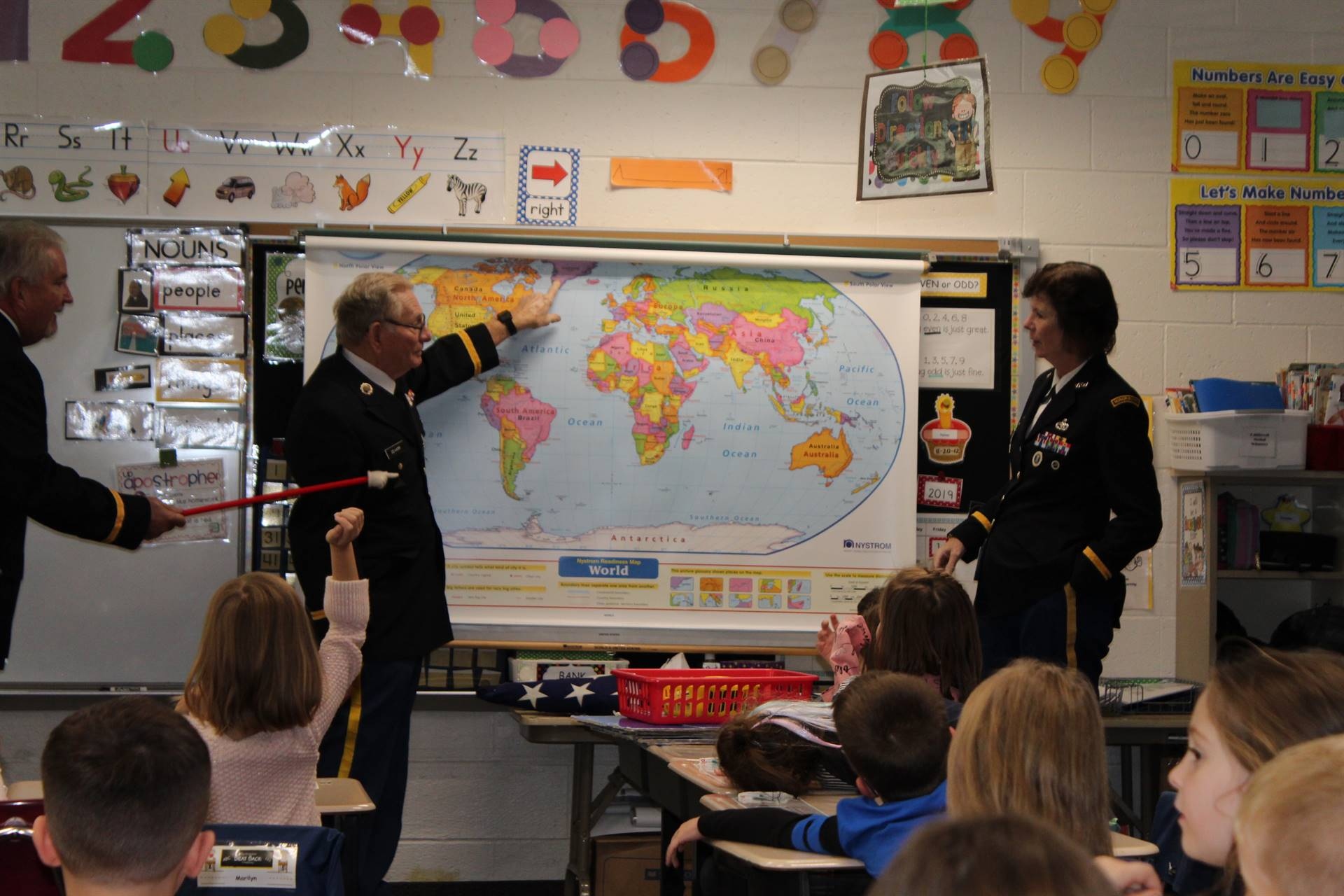 The Honor Guard uses a map of the world to show the students the countries they have visited