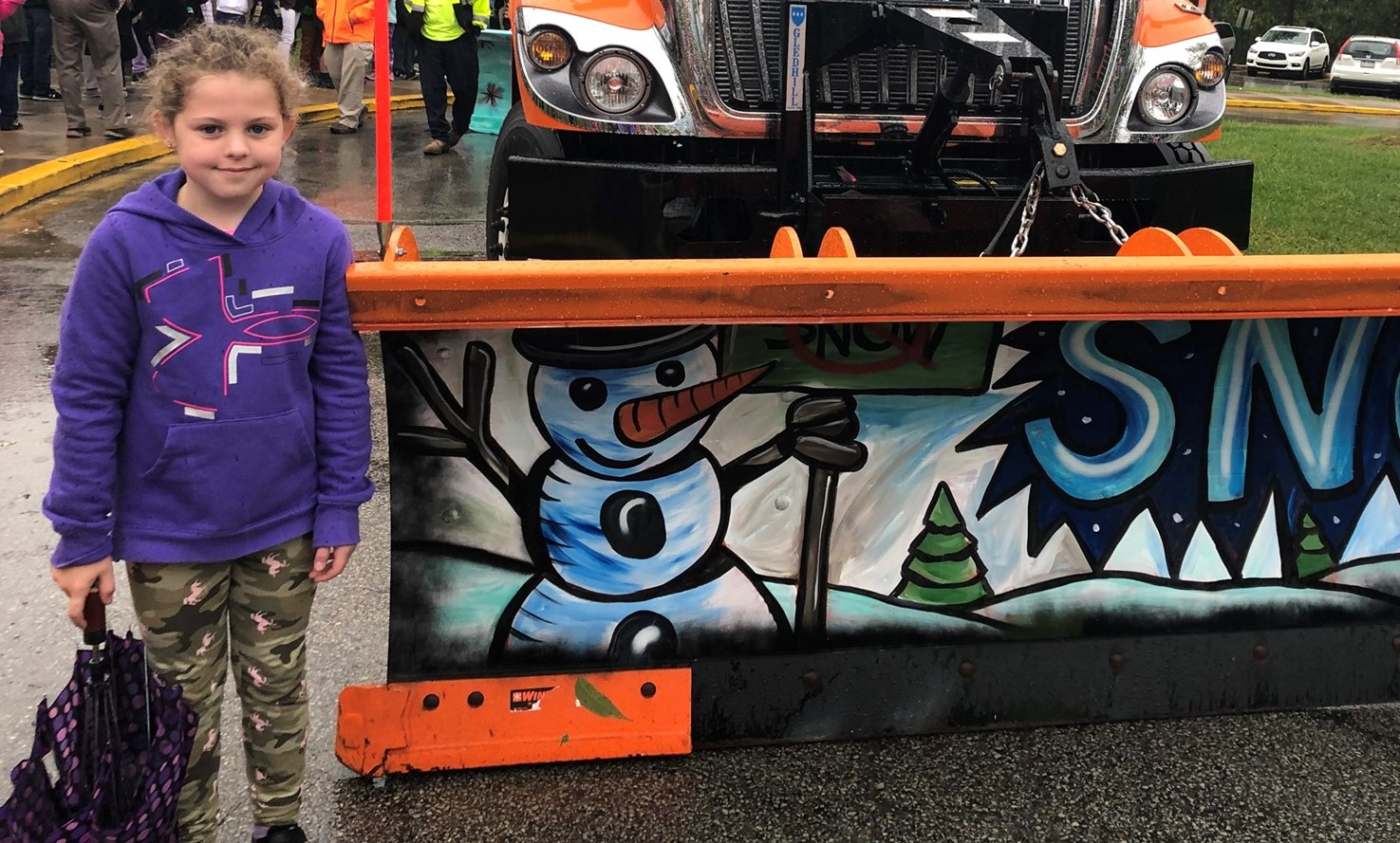 Student with her winning snow plow design