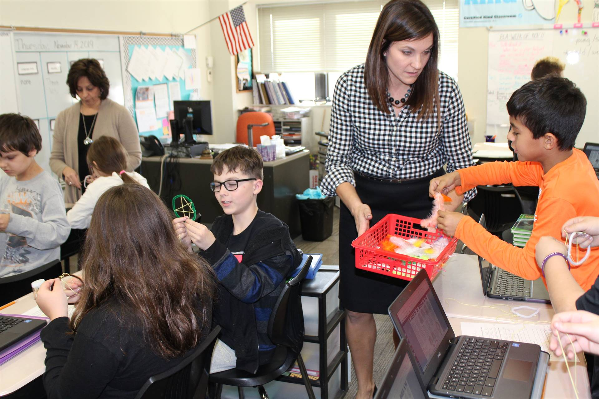 Mrs. Romito holding a basket of materials