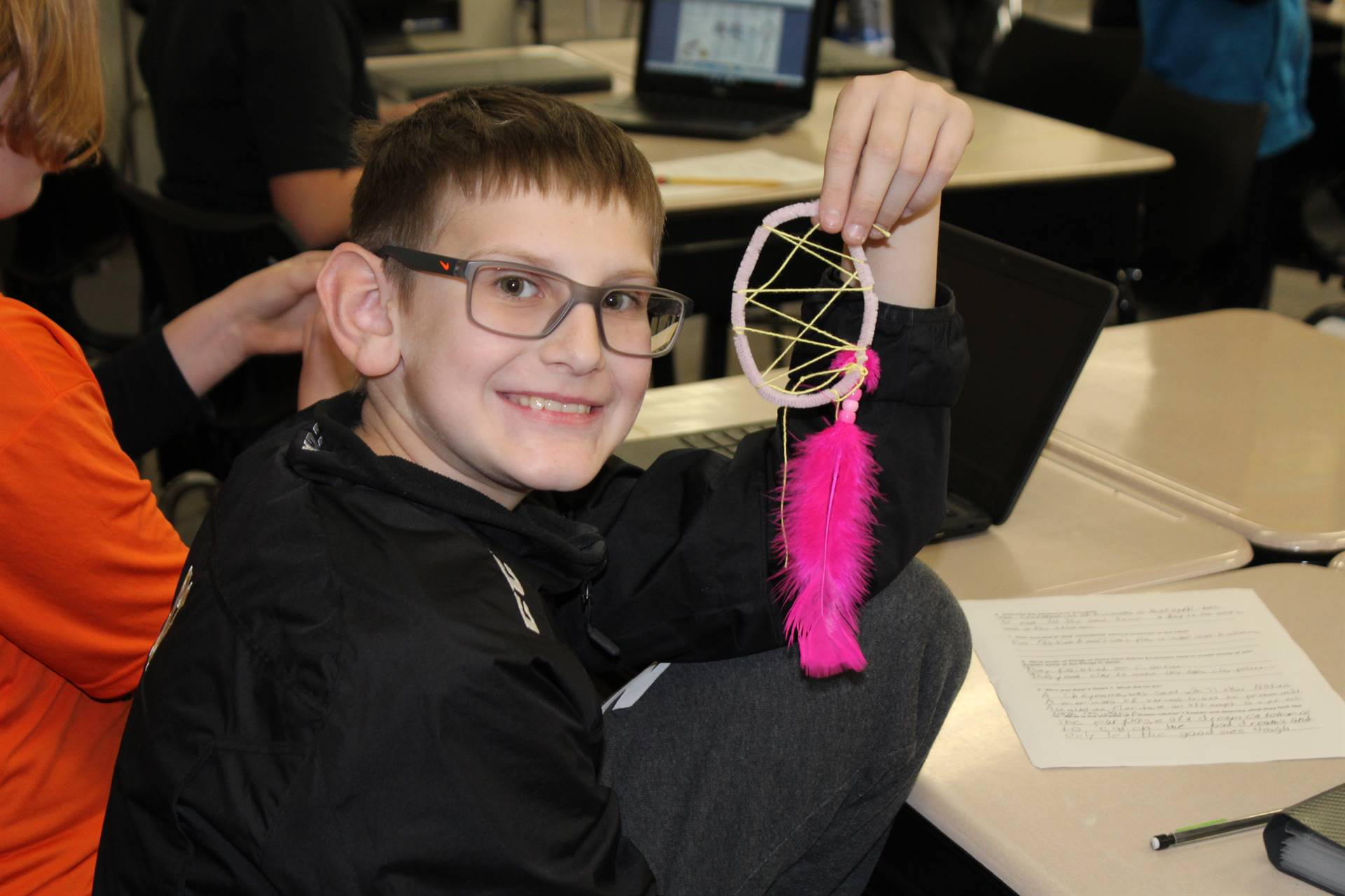 Student shows off the dream catcher he made