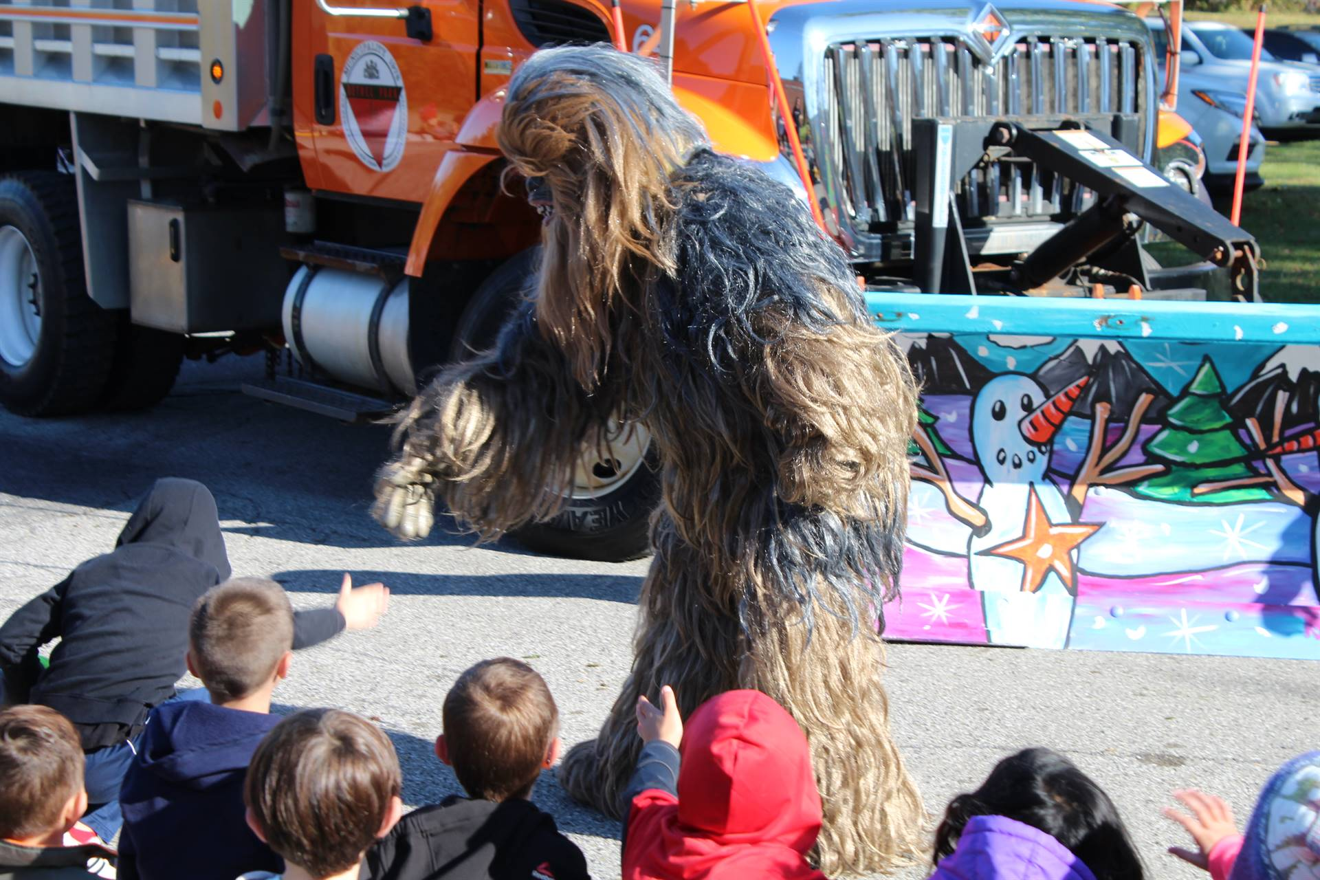 Chewbacca shaking students' hands