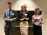 The three winners of the Principles of Business event