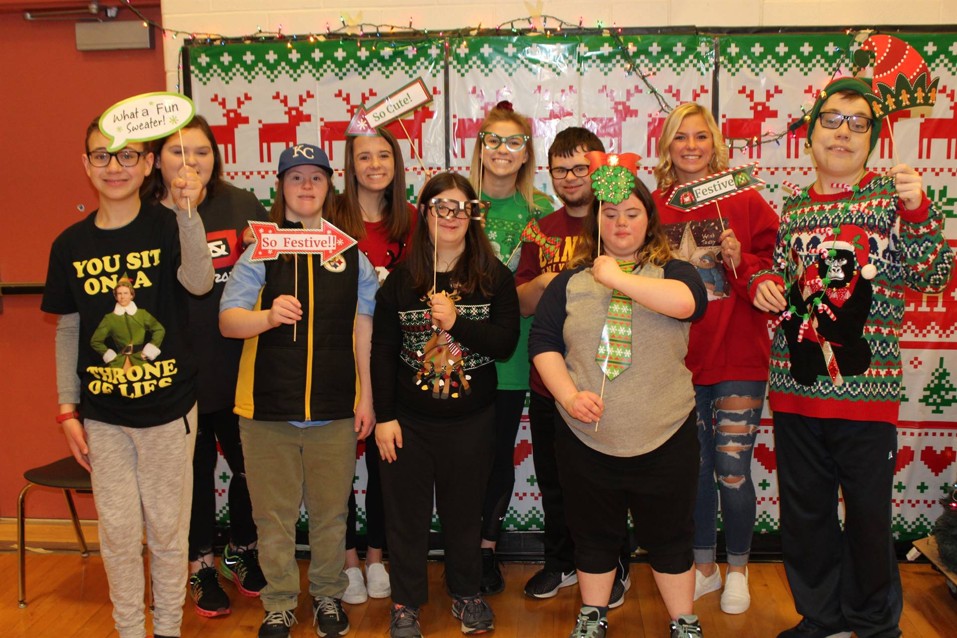 Students at the Holiday Sweater Party
