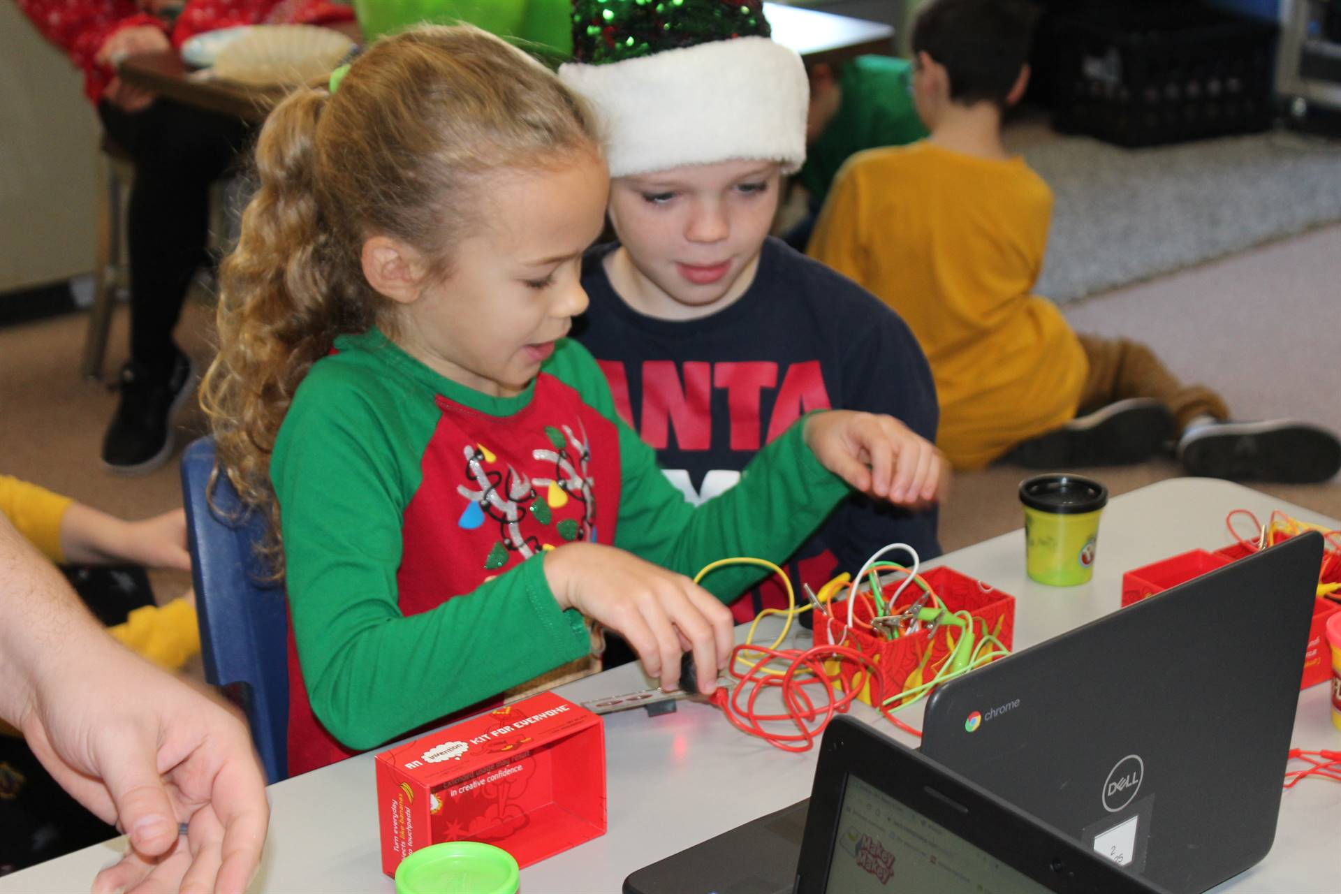 Two students working with Makey Makeys