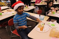Student with his gingerbread house