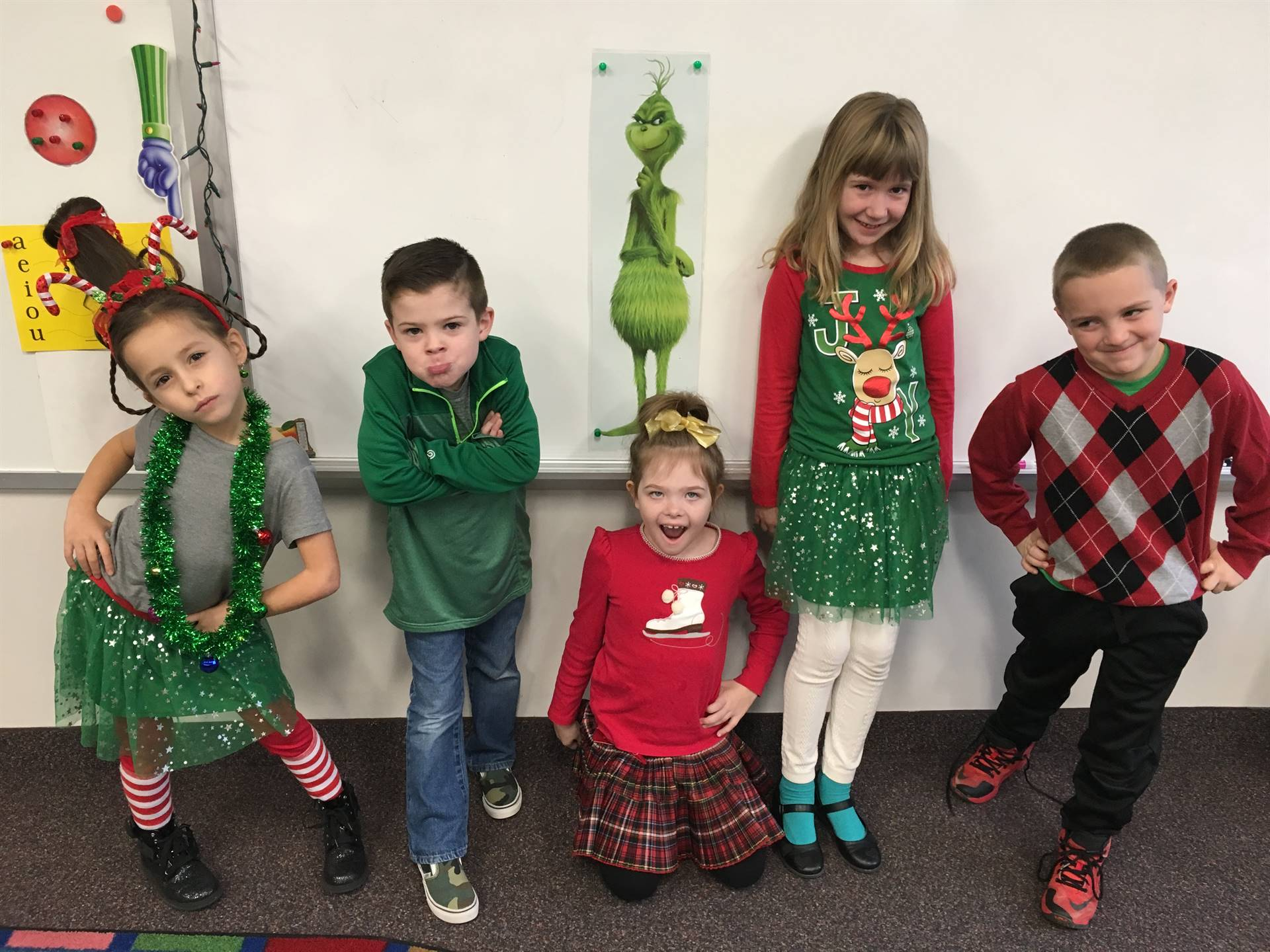 Five first graders making faces like the Grinch