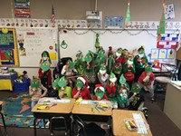 Group of students wearing Grinch masks