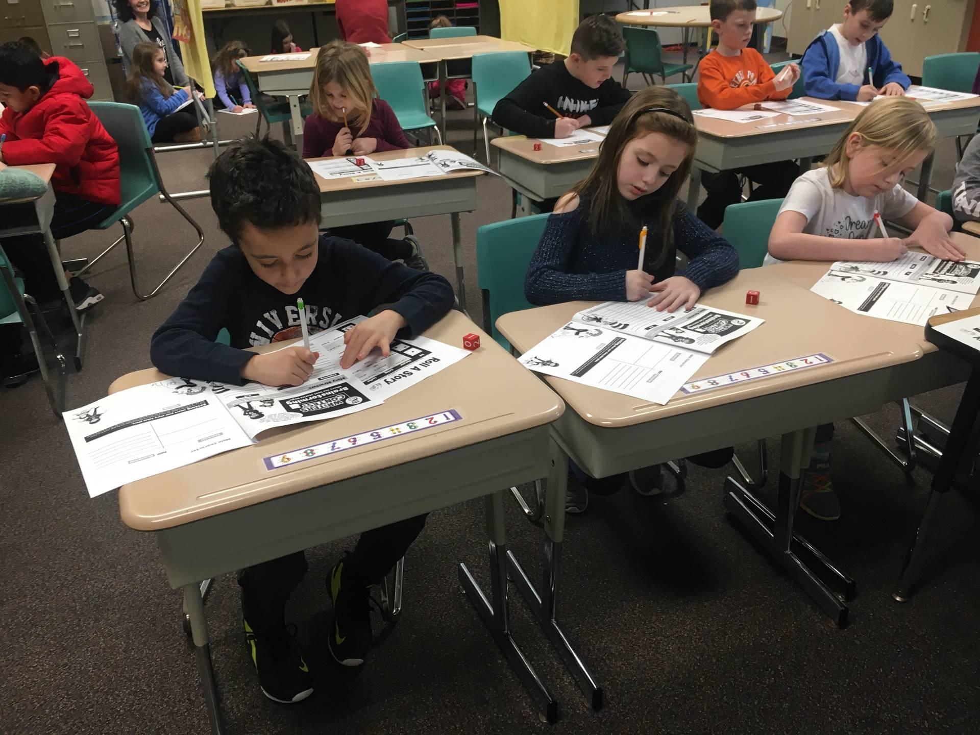 Three students working at desks