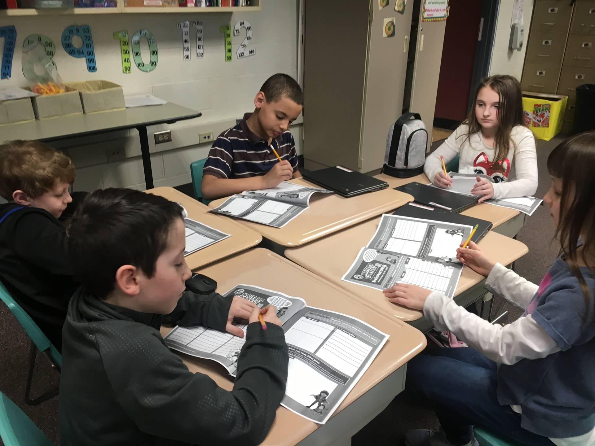 Five students working at desks
