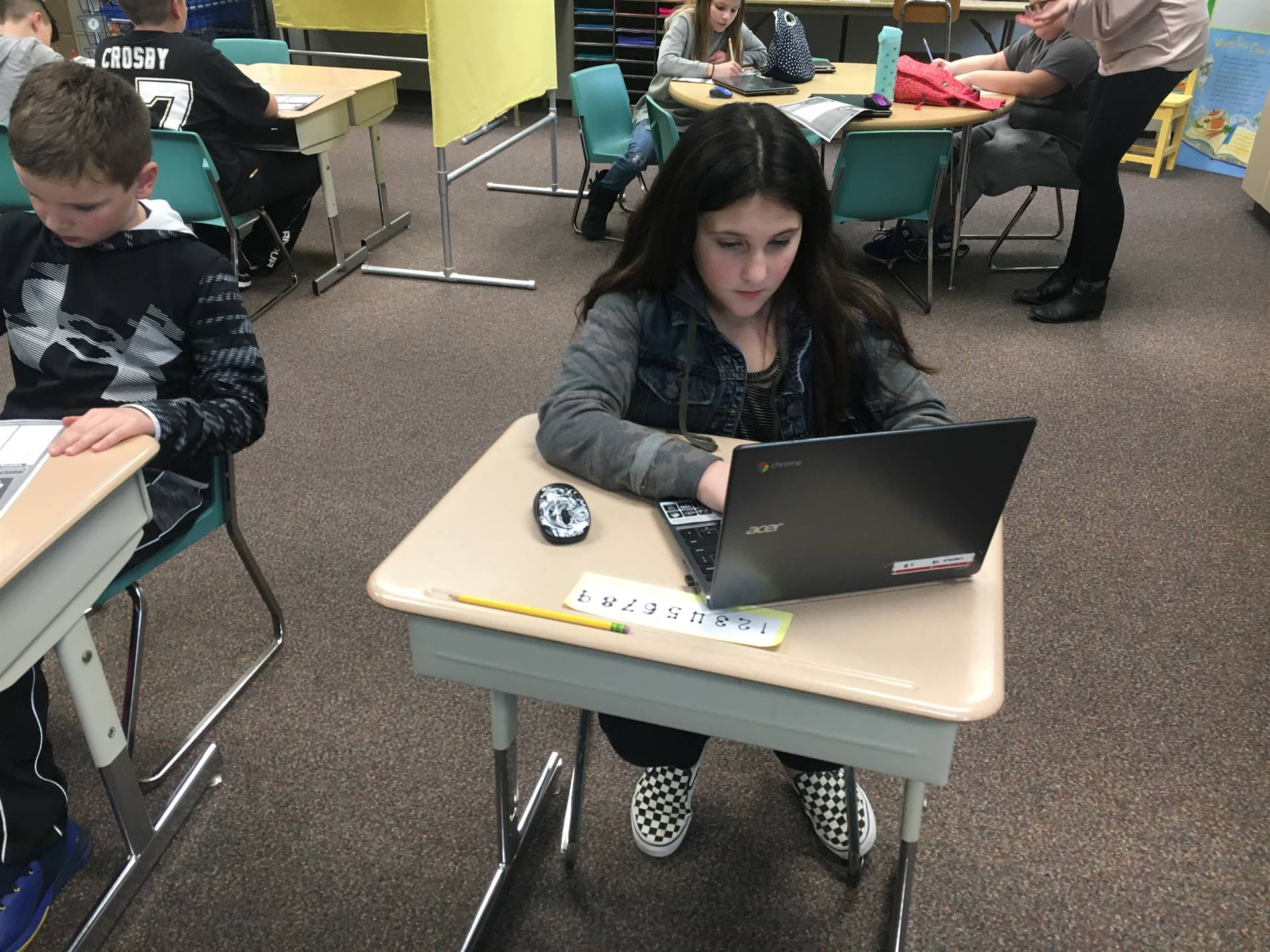 Student writing a story on her Chromebook