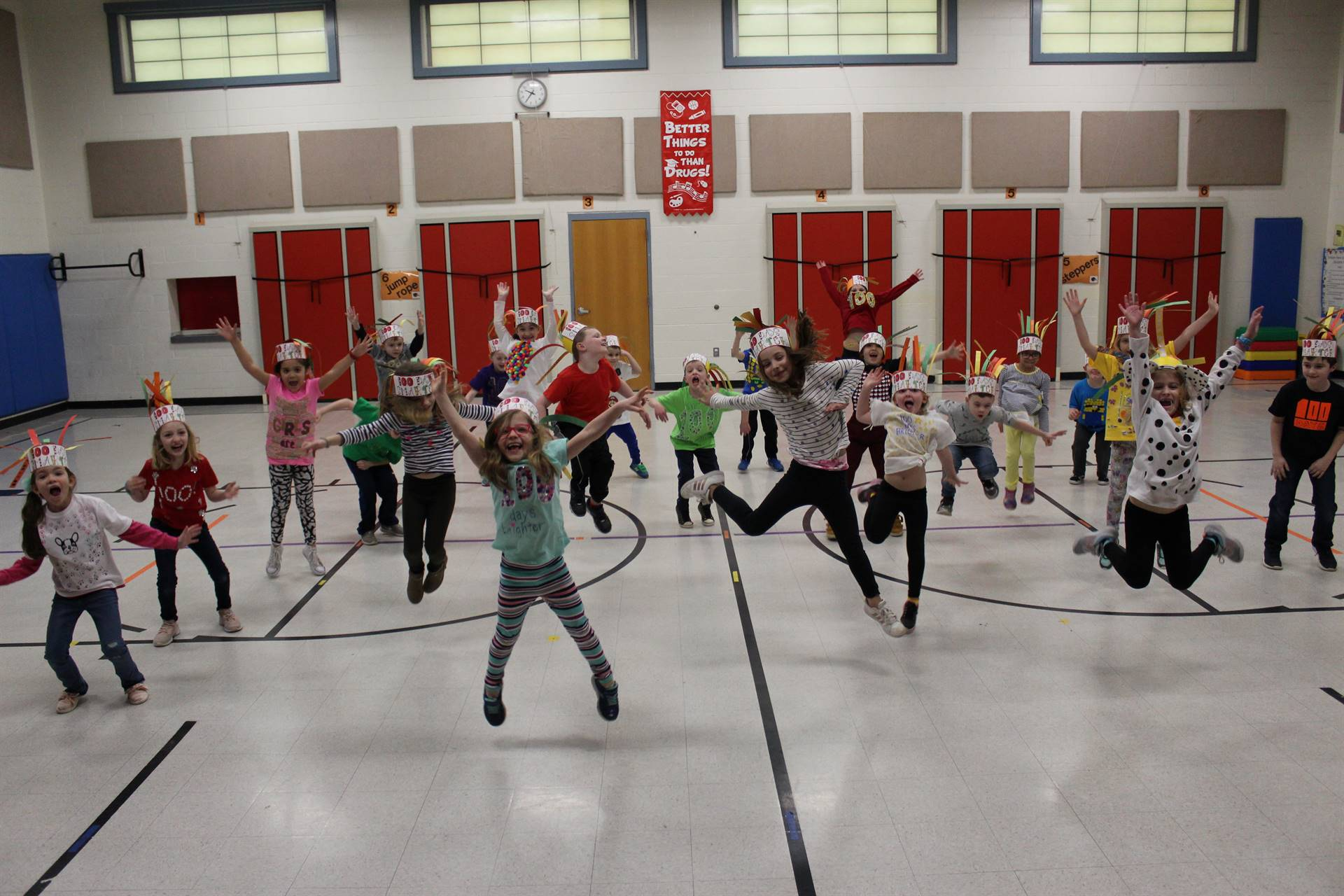 Students jumping in the air to celebrate the 100th day of school