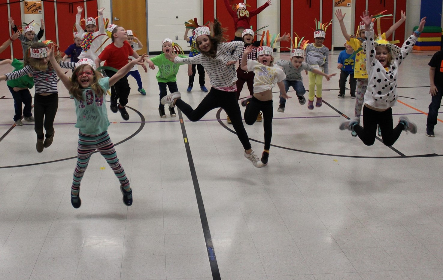 Penn students jumping for joy on the 100th day of school
