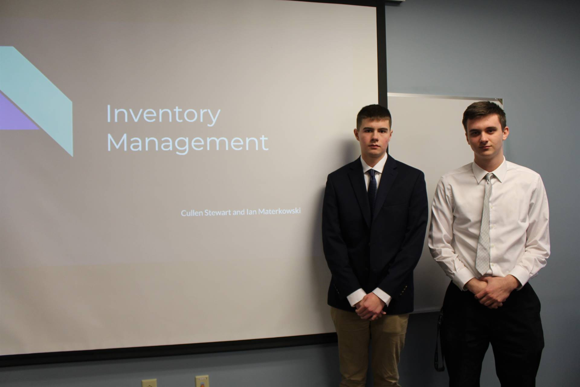 Two students with their presentation