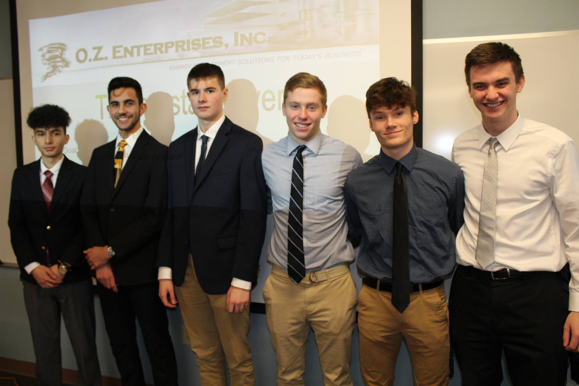 The six CIM class students who presented to O.Z. Enterprises
