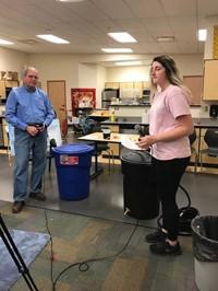 Haley demonstrating how to make a rain barrel for BPTV