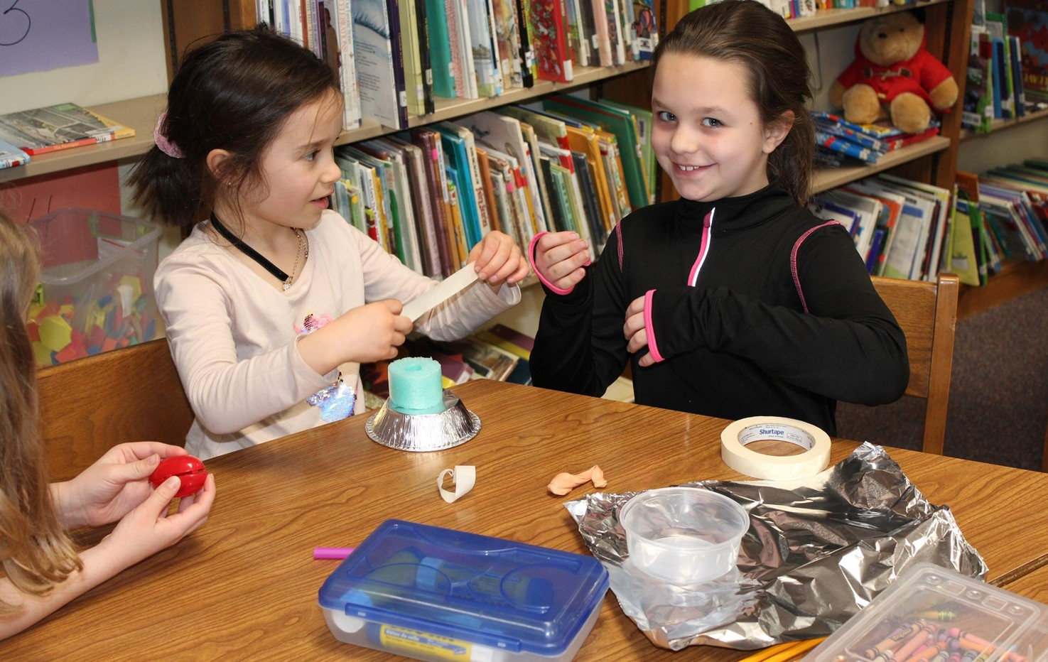 Two students working together on a science experiment